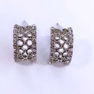 Silver diamond curved stud earrings